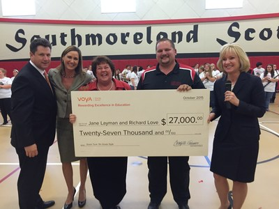 Voya Financial executives award teachers Jane Layman and Richard Love from Southmoreland Middle School in Scottdale, Pennsylvania with the first place prize for the 2015 Voya Unsung Heroes grant program, Friday October 30, 2015