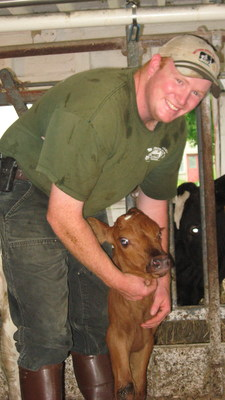 Ninth generation farmer John Franklin and a new calf