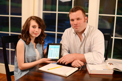 Isabel Hughes with the best-selling Fraction Calculator Plus that she helped to design with her father Aidan (right). The 12-year-old schoolgirl from Redmond, Washington, came up with the idea for a fraction calculator whilst doing her mathematics homework. Fraction Calculator Plus and its sister app Calculator Plus have now been downloaded over three million times, and the latter is the highest-rated app of all time on Amazon's Android App Store. NO REPRODUCTION FEE. Media information: Darren Hughes, MediaConsult,  353 86 293 7037. darren@mediaconsult.ie.  (PRNewsFoto/Digitalchemy LLC)