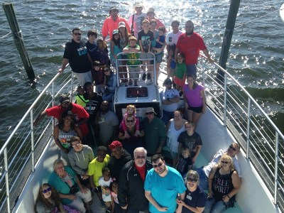 Wounded veterans and their families enjoy dolphin cruise.