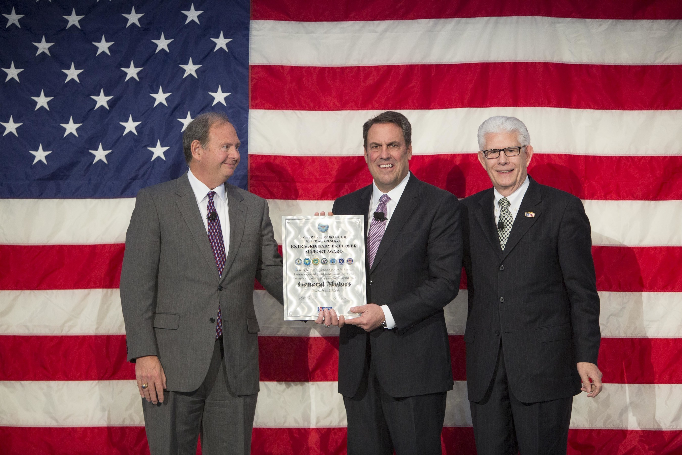 General Motors Executive Vice President Global Product Development, Purchasing and Supply Chain Mark Reuss (center) accepts the Employer Support of the Guard and Reserve Extraordinary Employer Support Award on behalf of GM during a Veterans Day celebration Tuesday, November 10, 2015 in Warren, Michigan. General Motors reaffirmed its commitment to employees serving in the National Guard and Reserve during the event. The award recognizes sustained commitment of companies for employees in the National Guard...