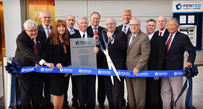 Members of PenFed's board of directors cut the ceremonial ribbon in front of the credit union's new headquarters in Tysons.