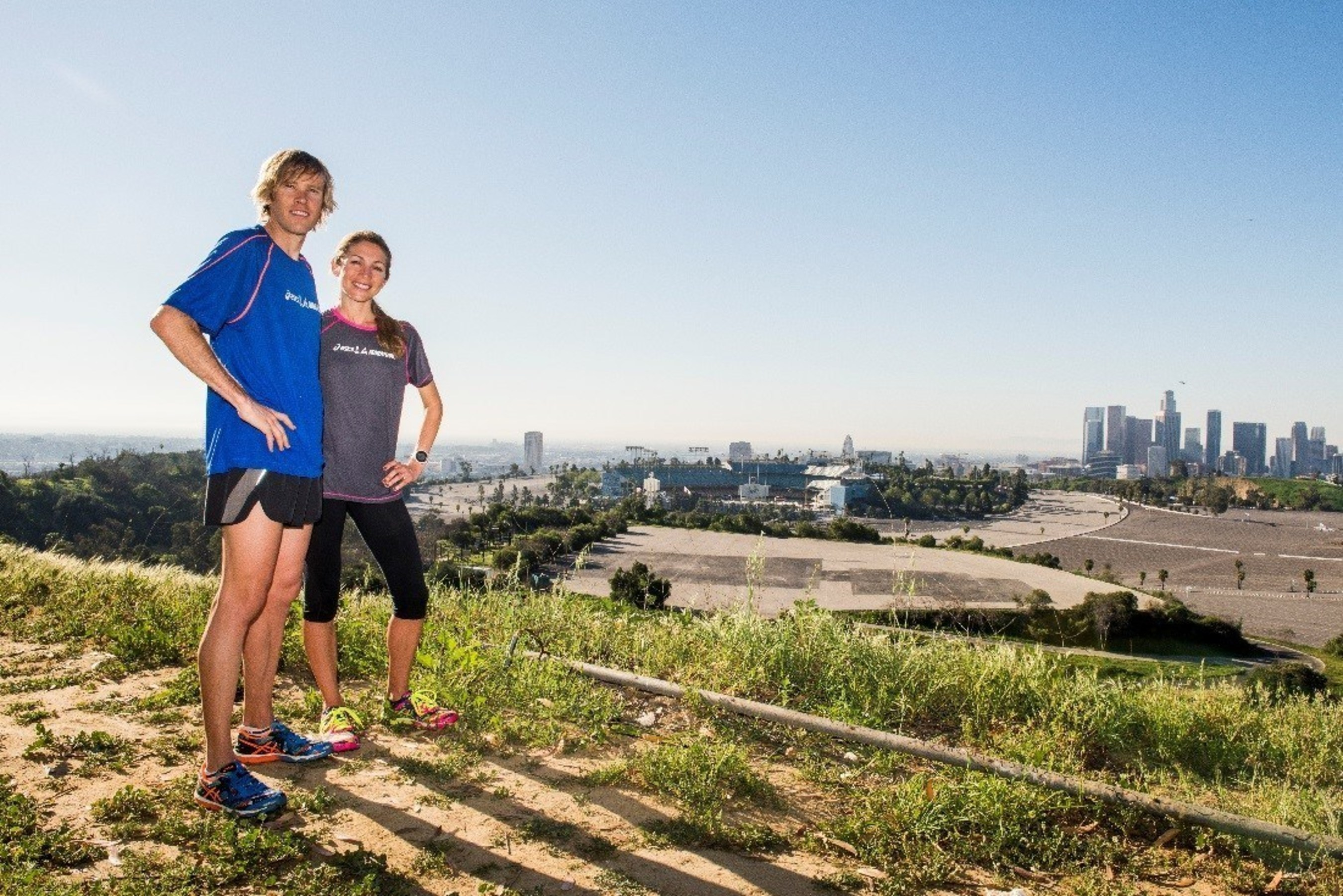 ASICS elite athletes Ryan and Sara Hall check out the ASICS LA Marathon course above Dodger Stadium in Los Angeles, California. (Photo credit:  Jonathan Moore/Getty Images for ASICS)