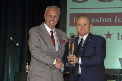 Jim Reid-Anderson, Chairman, President and CEO of Six Flags accepts Heritage Award from David Teel, President and CEO of the Texas Travel Industry Association (TTIA) (PRNewsFoto/Six Flags Entertainment Corp...)