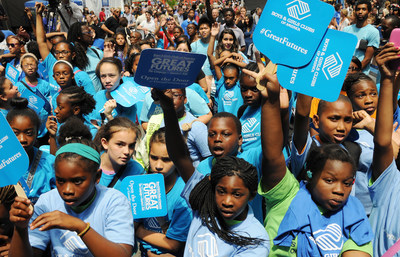 """Kids cheer during a stage performance at Boys & Girls Clubs of America's launch of the Great Futures Campaign to call attention to the critical role of out-of-school time for kids on Thursday, July 31, 2014 in Times Square, New York. BGCA took over Times Square to """"redefine the opportunity equation"""" and garner support for after-school and summer programs that empower youth toward success. (PRNewsFoto/Boys & Girls Clubs of America)"""