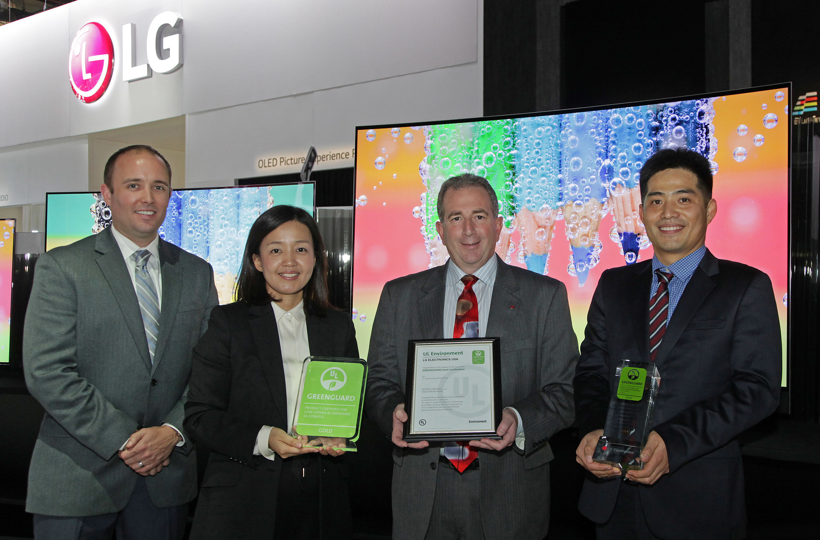Celebrating UL Environment GREENGUARD certification for LG Electronics' 55-, 65-, and 77-inch class 4K OLED TVs at the 2015 International CES are left to right: Donald Mayer, Global Business Development Manager, UL Environment, Jamie Yeom, Global Account Director, Business Development & Marketing, UL Korea Ltd., Tim Alessi, LG's U.S. Head of New Product Development, and J.C. Lee, LG's U.S. Head of Standards and Environmental Compliance.
