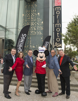 Disney Springs Vice President Keith Bradford, Disney Springs and ESPN Wide World of Sports Complex Senior Vice President Maribeth Bisienere, Walt Disney World Resort President George A. Kalogridis, Mickey Mouse, Chef Masaharu Morimoto and Patina Restaurant Group CEO Nick Valenti celebrate the opening of Morimoto Asia Sept. 29, 2015 at the newly named Disney Springs complex at Walt Disney World Resort in Lake Buena Vista, Fla. Re-imagined from Downtown Disney, Disney Springs is doubling the number of shopping, dining and entertainment experiences opening in phases through 2016. (David Roark, photographer).
