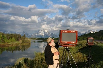 "Legendary landscape photographer Clyde Butcher sets up his cameras -- his 5""x7"" Deardorff is dwarfed by his massive 12""x20"" (40lb) Wisner to capture a photo series at iconic Oxbow Bend, located in Grand Tetons National Park. Butcher has spent 50 years photographing 33 U.S. National Parks to create a timeless collection highlighted in his new book ""Celebrating America's National Parks."""