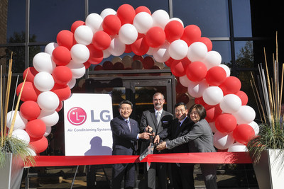 President and CEO LG Air Conditioning & Energy Solutions Hwan-Yong Nho with LG Electronics USA President and CEO William Cho and senior vice presidents Kevin McNamara and Ellen Kim perform the official ribbon cutting at the grand opening of LG Electronics USA Air Conditioning Systems headquarters on Wednesday, November 11, 2015, in Alpharetta, GA. (Photo by John Amis/AP Images for LG Electronics USA)