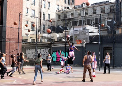 The Harlem Globetrotters and the group STOMP took to an outdoor basketball court in New York City's Greenwich Village to celebrate the Globetrotters' 90th year.