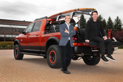 """Pietro Gorlier, President and CEO Mopar, and Mark Trostle, Head of Mopar, SRT and Motorsports Design, reveal the Ram Sun Chaser, featuring a makeshift shower kit and concept """"Flip-Up"""" seatback tailgate, as one of 20 modified vehicles that are headed to the 2013 SEMA show in Las Vegas in November. (PRNewsFoto/Chrysler Group LLC)"""