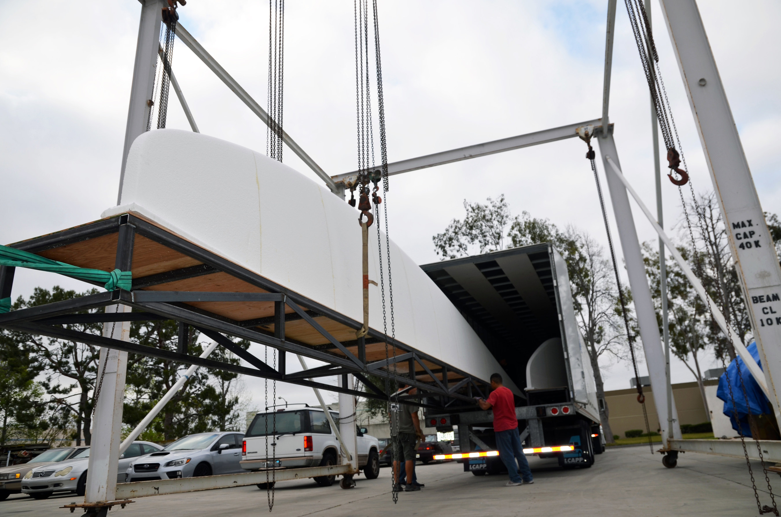 """The surfboard for Huntington Beach's record-breaking attempt is 42' 1/4"""" long, 11' 1"""" wide and 16"""" thick. The two halves of the board arrived in Orange County on April 20, 2015, from mouldCAM in Rhode Island via tractor-trailer."""
