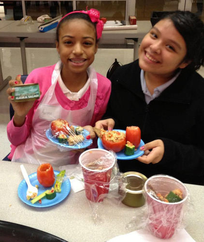 Two students in the Kips Bay Boys and Girls Club cooking class with their Copper River salmon creations. ...