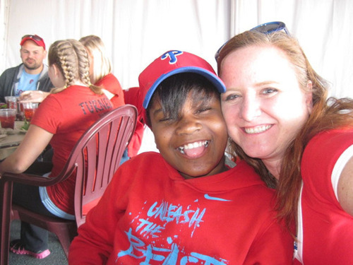 It's all smiles as Treneal Chambers (left), a fifth-grade student at Chester Community Charter School (CCCS), the largest K-8 charter school in Pennsylvania, poses with Shannon McGarry, a teacher at the school, as they attend the May 11, 2012 Philadelphia Phillies Teacher Appreciation baseball game, as part of the team's 2012 Teacher All-Star Contest, where Chambers essay/nomination earned four tickets for her, and McGarry. The contest, which looks to honor local teachers, is hosted by The Philadelphia Phillies and the Newspapers in ...