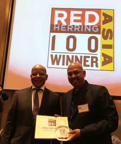 Snehashish Bhattacharjee, Global CEO, Denave receiving the Red Herring Top 100 Asia Trophy (PRNewsFoto/Denave)