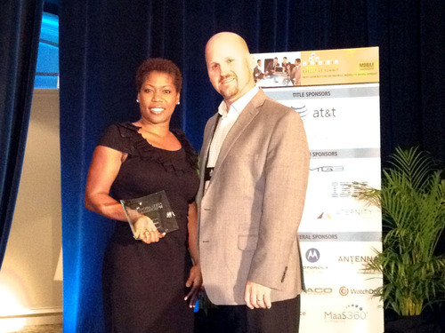 Kimberly Jackson, Sr. Manager of Enterprise Mobility & Wireless Solutions of American Airlines, accepting the ...