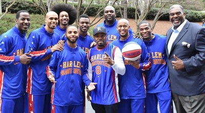 Grammy Award-winning producer/songwriter Teddy Riley, No. 8, poses with the Harlem Globetrotters.