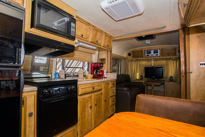This wonderful 34' Silver Avion luxury trailer was the pride of the highway back in the day, and will optimally sleep four people, with other beds for two more people. Dining area converts to sleeping area that sleeps two, plus two full-size sofa beds that each sleep two. The restored interior offers a fully-furnished kitchen area with range, microwave, refrigerator and bath. Deck has outdoor furniture and a gas grill. Includes linens and flat screen TV with Blue-ray player.