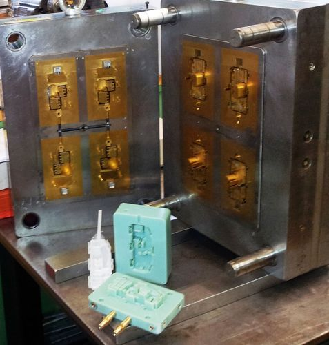 Stratasys additive manufacturing compared to CNC tooling: 3D printed injection mold and resulting part next to ...