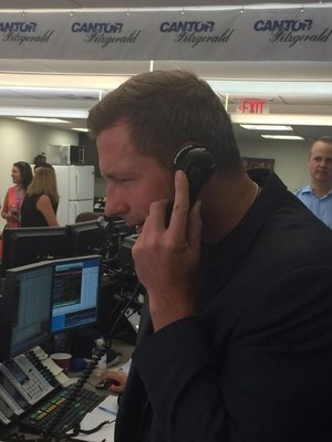 Actor and director Ed Burns on the phone representing charities that included Comfort Zone Camp at Cantor Fitzgerald's annual Charity Day on September 11, 2015.