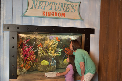 A mother and daughter view colorful coral in the Neptunes Kingdom aquariums in the Pre Show I area before entering the SpongeBob SubPants Adventure theater. The new attraction opens Memorial Day weekend at Moody Gardens in Galveston, Texas.