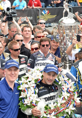 Standing beside the Borg-Warner Trophy(TM) in Victory Lane, BorgWarner President and Chief Executive Officer James Verrier congratulated Tony Kanaan on his victory at the Indianapolis 500. (PRNewsFoto/BorgWarner Inc., Photo courtesy of Rob Banayote)
