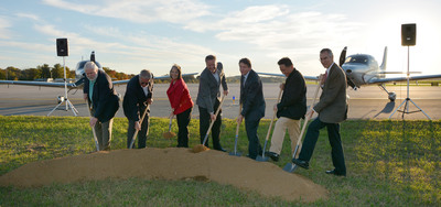 Cirrus Co-Founder and CEO Dale Klapmeier (fourth from right) and Chairman of the Board Bian Tao (second from right) participate in the groundbreaking of the company's new Vision Center at McGhee Tyson Airport in Knoxville with airport and Tennessee officials.