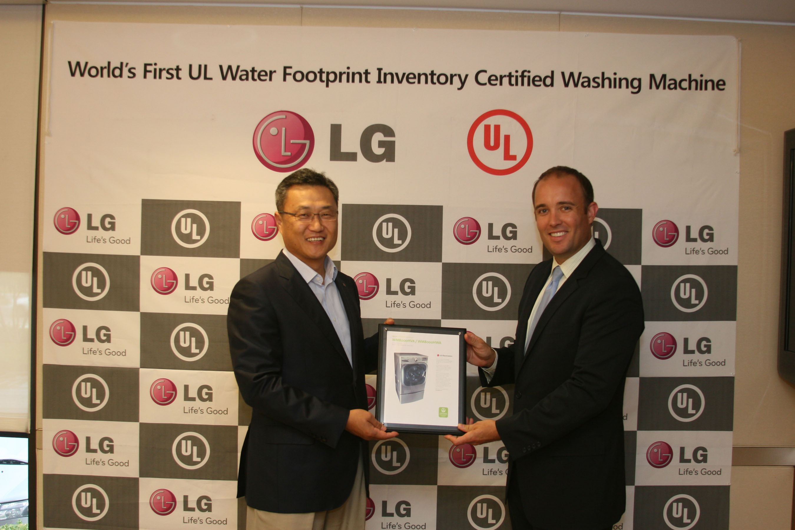 Celebrating the first Water Footprint UL certification for washing machines are Chris Jung, president, LG Electronics USA Home Appliances (left), and Donald Mayer, commercial business development leader, UL Environment.    (PRNewsFoto/LG Electronics USA, Inc.)