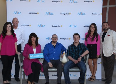 Aflac Duckprints honorees, (L-R) Mandy Monks, Richard Monks, Denise Monks, Joel Nava, the Aflac Duck, Scott Starr, Michelle Monks and Lucky Romero.