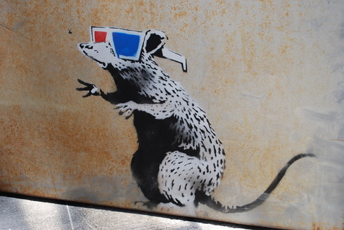 """Dirty Rat"" Banksy street art painted on the door of The Egyptian Theatre in Park City, Utah. (PRNewsFoto/The Egyptian Theatre)"