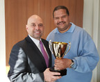 Gene Nicotra, General Manager at New York's Hotel Pennsylvania, awards Ruben Hernandez for his heroic efforts