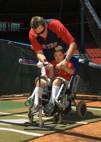 At a CVS Caremark All Kids Can Baseball Camp, Dave Magadan coaches a child.  (PRNewsFoto/CVS Caremark)