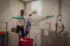 Prospective health-care workers in the Kerry Town Ebola Treatment Center test decontamination procedures in Sierra Leone. Photo by Louis Leeson/Save the Children.