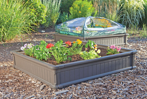 Lifetime's Raised Garden Bed gives you the perfect garden setup in less than one hour. It is constructed of UV-protected high-density polyethylene (HDPE) with a simulated wood design. It is low-maintenance, weather resistant, and will not rot, crack, or peel. The walls are 9 inches high, and two beds can be stacked together to create 18 inch walls to accommodate deep rooted plants. With its easy do-it-yourself assembly and low-maintenance features, gardening has never been this easy.  (PRNewsFoto/Lifetime Products, Inc.)