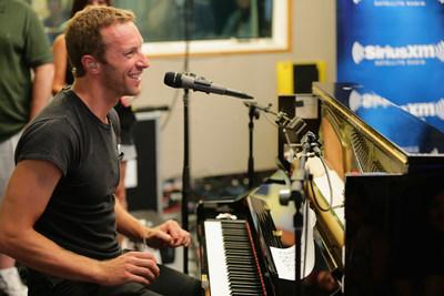 Chris Martin of Coldplay Performs for SiriusXM's Artist Confidential Series in the SiriusXM studios. Photo Credit: Neilson Barnard. (PRNewsFoto/Sirius XM Holdings Inc.)