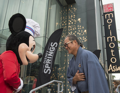 Mickey Mouse and Chef Masaharu Morimoto bow in celebration of the opening of Morimoto Asia Sept. 29, 2015 at the newly named Disney Springs complex at Walt Disney World Resort in Lake Buena Vista, Fla. Re-imagined from Downtown Disney, Disney Springs is doubling the number of shopping, dining and entertainment experiences opening in phases through 2016. (David Roark, photographer).