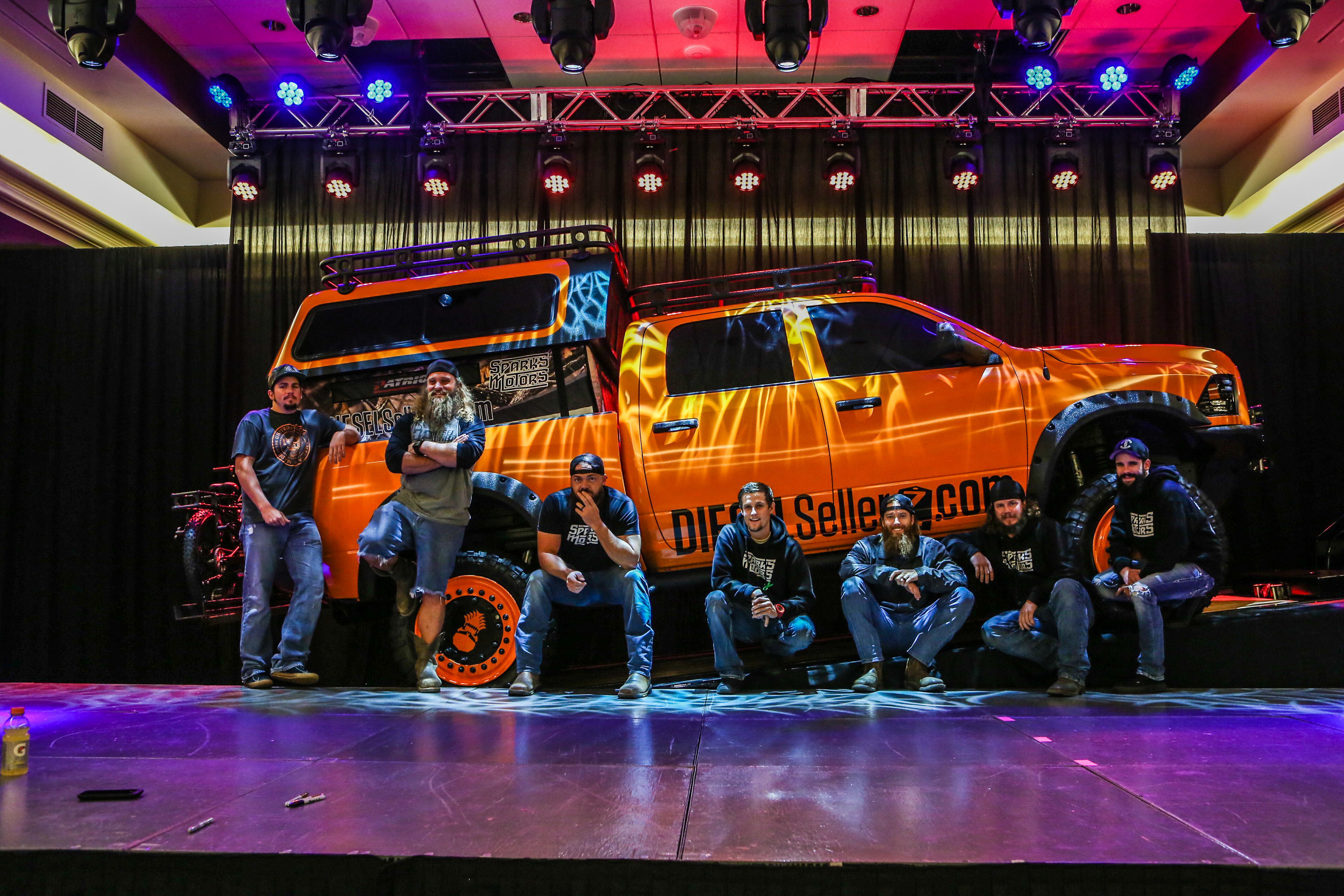 """Diesel Brothers team in front of diesel truck custom built for Seven Feathers Casino Resort in Canyonville, OR. Pictured from left to right Chet """"Shop Goon"""", Diesel Dave, Heavy D, Hans, Red Beard, Tyson """"Shop Viking, D.J. """"Thinmint""""."""