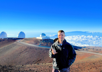 The author at the top of Mauna Kea volcano. (PRNewsFoto/Joe Holt)