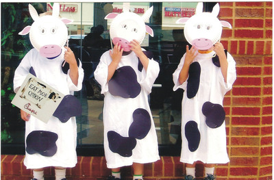 """Three """"calves"""" attend Cow Appreciation Day at Chick-fil-A! As part of the ninth annual celebration on July 12, Chick-fil-A is offering a free combo meal to any customer who visits one of its 1,700-plus restaurants fully dressed as a cow.  (PRNewsFoto/Chick-fil-A, Inc.)"""