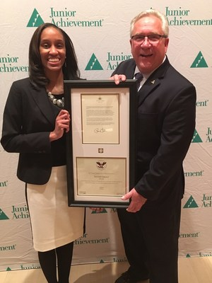 Rick Franke, JA of Southeast Texas President, presents the U.S. President's Volunteer Service Silver Award to Nicole Wilson of LyondellBasell.