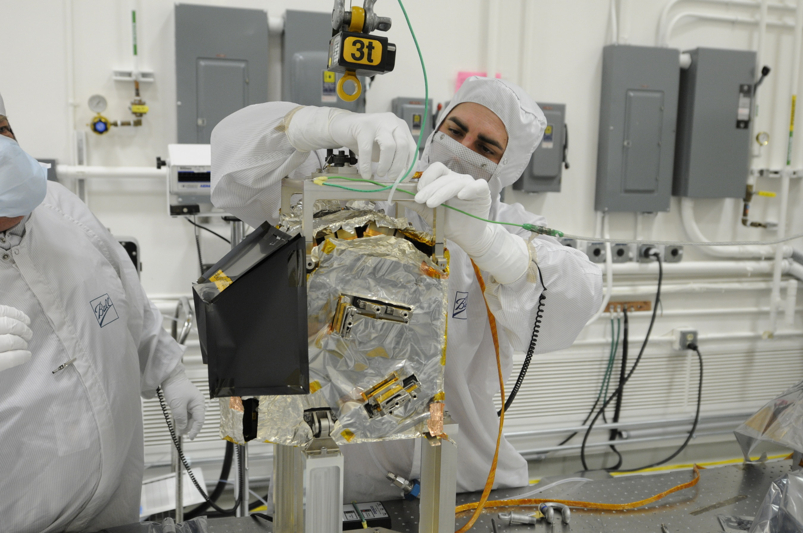 A Ball Aerospace technician prepares to integrate the Ozone Mapping Profiler Suite (OMPS) to the Joint Polar Satellite System spacecraft.  OMPS and the Clouds and Earth's Radiant Energy System are the first two of five instruments to be integrated to JPSS-1, the nation's next polar-orbiting weather satellite for NOAA and NASA, scheduled to launch in 2017.