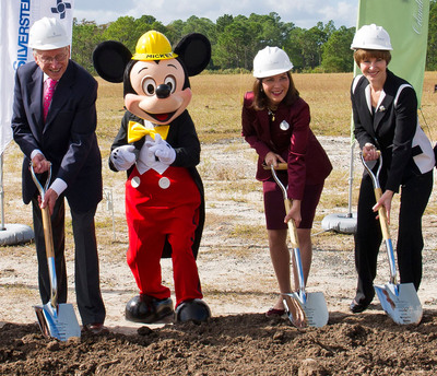 FROM LEFT TO RIGHT: Larry Silverstein, president and CEO of Silverstein Properties, Mickey Mouse, Meg Crofton, president, Walt Disney Parks and Resorts Operations, U.S. and France, and Kathleen Taylor, president and CEO of Four Seasons Hotels and Resorts.  (PRNewsFoto/Walt Disney World Resort)