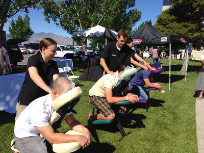 Incorporate Massage providing onsite corporate chair massage at an outdoor employee health fair.