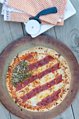 """Just in time for Independence Day, """"A Night Owl"""" blogger Kimberly Sneed uses a new DIGIORNO DESIGN A PIZZA kit to build a patriotic pizza. DESIGN A PIZZA kits come with individually packaged pizza toppings and a full-size DiGiorno cheese pizza, allowing everyone to create his or her own perfect slice."""