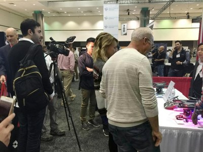 Visitors and journalists in front of FLYPRO UAV's booth