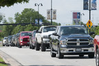 Ram Trucks parade near AT&T Stadium while setting a new Guinness World Records title for largest parade of pickup trucks with 451, in Arlington, Texas, Saturday, April 18, 2015.  The 'Ram Truck Round-up' was held in conjunction with the 50th Academy of Country Music Awards weekend.