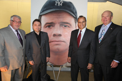 "To commemorate the opening of Aaron's, Inc. 2,000th store in the Bronx, Aaron's and former Yankees manager Joe Torre presented the National Baseball Hall of Fame and Museum with ""Babe Ruth"" by Rossin, a 72-inch x 60-inch oil on canvas painting. Pictured from left to right are Ken Butler, Aaron's COO; Rossin, internationally acclaimed portrait artist; Joe Torre, legendary baseball manager and Major League Baseball's Executive Vice President for Baseball Operations; and Ronald W. Allen, Aaron's CEO and President.  (PRNewsFoto/Aaron's, Inc.)"