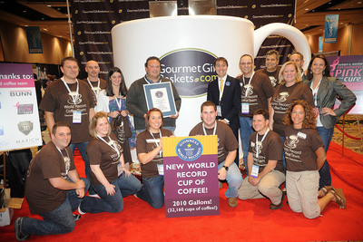 THE WORLD'S LARGEST CUP OF COFFEE CROWNED OFFICIAL: GourmetGiftBaskets.com doubles previous Guinness World Record with a cup of java holding 2,010 gallons!. (PRNewsFoto/GourmetGiftBaskets.com, Jacob Kepler)