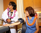 Honolulu, Hawaii, Sept. 26, 2013- MinuteClinic Nurse Practitioner Tara Davis performed a blood pressure check on Hawaii State Senate President Donna Mercado Kim at the new MinuteClinic walk-in medical clinic inside the Longs Drug Store in Moiliili. The clinic, open seven days a week, is the first of seven MinuteClinic locations opening on Oahu in the next two weeks.  (PRNewsFoto/MinuteClinic/Derwin Hayashi)