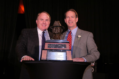 "TCU's Coach Gary Patterson winner of the  American Heart Association 2014 Paul ""Bear"" Bryant Coach of the Year Award and Marc Bryant Tyson, grandson of Coach Paul ""Bear"" Bryant."